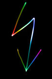 Neon lightning. Flourescent symbol of a lightning in different neon colors Stock Photos
