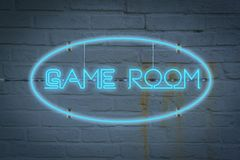 Neon lighton the wall with the word GAME ROOM royalty free stock photo