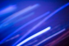 Neon lights background, abstract lines in motion. Technology, defocused textures and futuristic design concept - Neon lights background, abstract lines in motion royalty free stock photography