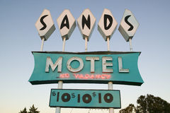 Neon lights come on at sunset at Sands Motel with RV Parking for $10, located at the intersection of Route 54 & 380 in Carrizozo,  Stock Images