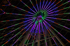 Neon lights on Ferris wheel Stock Images