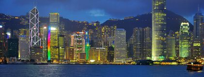 Neon lights at Hong Kong Harbour buildings stock photography