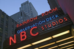 Neon lights of NBC Studios and Rainbow Room at Rockefeller Center, New York City, New York Stock Image