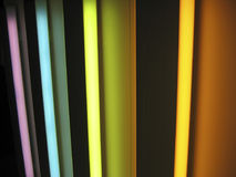 Neon lights rainbow. Multi-colored vertical neon lights forming a rainbow - horizontal layout Stock Photos