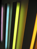 Neon lights rainbow - vertical. Multi-colored vertical neon lights forming a rainbow - vertical layout Stock Images