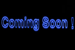 Neon lights sign coming soon blue. Exclamation mark blau backgrounds colors stock photography