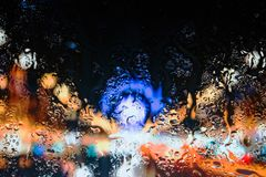 Lights behind water drops close up in street city royalty free stock image