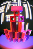 Neon lights on wooden toy building blocks Stock Photography