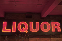 Neon liquor sign. Over a bar in a pub or tavern royalty free stock photos