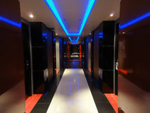 Neon lit modern hotel hallway Stock Images