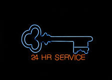 Neon Locksmith Sign. Neon 24 hours Locksmith Sign with a Key royalty free stock photography