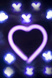 Neon love heart shape sign at night Royalty Free Stock Photos