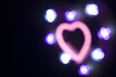 Neon love heart shape sign at night Stock Image