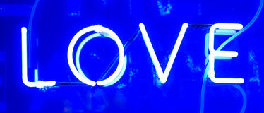 Neon Love Sign. Blue Illuminated Neon Love Sign Stock Images