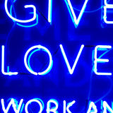 Neon Love Sign. Blue Illuminated Neon Love Sign Royalty Free Stock Images
