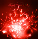 Neon maple leaf on the dark. Background for canada day with fireworks Royalty Free Stock Photo