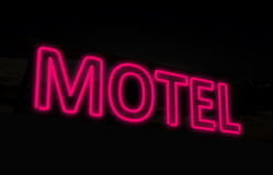 Neon motel sign. A purple neon motel sign Stock Photography