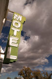 Neon Motel Sign Clear Blue Sky White Billowing Clouds Stock Images
