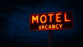 Motel Sign Lit Up At Night. Neon motel sign in the dark stock video footage