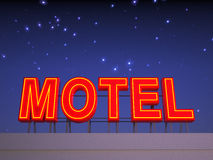 Neon motel sign with a night sky. Royalty Free Stock Images