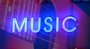 Neon music sign. Neon sign music abstract background royalty free stock images