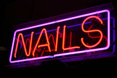 Neon Nails Sign. Lights up a beauty salon Stock Images