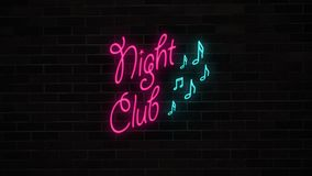 Neon Night club sign with notes  on grunge brick wall. Neon Night club sign with notes turning on and blinking on grunge brick wall. Night music bar for party Stock Image