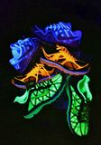 Neon Nike Shoes. 3 separate pairs of neon nike shoes. neon blue and white; neon orange, neon green Royalty Free Stock Image