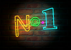 Neon Number One Sign On A Face Brick Wall. An illuminated colorful neon sign with the word Number One on it mounted on a brick wall Royalty Free Stock Photo