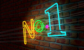 Neon Number One Sign On A Face Brick Wall. An illuminated colorful neon sign with the word Number One on it mounted on a brick wall stock photo