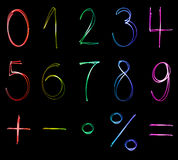 Neon numbers. Different flourescent numbers and math symbols in different neon colors Stock Photo