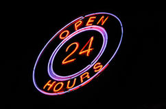 Neon 'Open 24 hours' sign. Pink & blue neon Open 24 hours sign at night Stock Photography