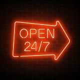 Neon open 24 hours 7 days a week sign in geometric arrow shape on a dark brick wall background. Round the clock working bar or night club signboard with Stock Photo