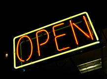 Neon OPEN sign. Orange & yellow neon open sign at night Royalty Free Stock Image