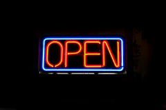 Neon OPEN Sign. A neon OPEN sign commonly seen in businesses Stock Image