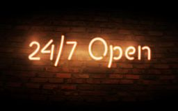 Neon Open 24/7 sign on brick wall background. Realistic glowing neon inscription. Open 24 Hours Royalty Free Stock Photos