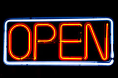 Neon Open sign in cafe window. Neon Open sign lit at night Royalty Free Stock Photography