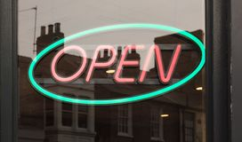 Neon open sign. In a shop window stock image