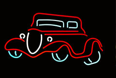 Neon Outline of an Antique Car. Very popular anituque car year outline in neon done in red, and white against black background Stock Images