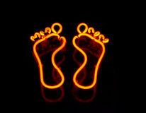 Neon pair of feet Royalty Free Stock Photos