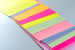 Neon paper color for background. Striped geometric pattern of bright colors. stock photos