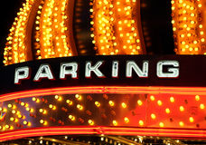 Neon parking sign. Bright and blinking neon and gold lights advertising parking near a casino Stock Images