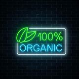 Neon 100 percent organic production sign on dark brick wall background. Natural cosmetics glowing advertising symbol. Vector illustration Stock Image