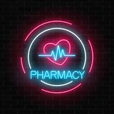 Neon pharmacy glowing signboard with heart shape and pulse graph in circle frames on brick wall background. Neon pharmacy glowing signboard with heart shape and Stock Images
