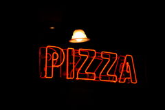 Neon Pizza Sign. Red on black background Stock Photos