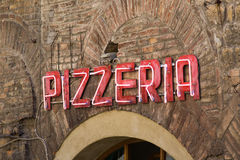 Neon pizzeria sign Stock Images