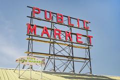 Neon public market sign against sky Stock Images