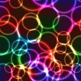 Neon rainbow color bright bubbles - seamless background. Shining neon rainbow color bright bubbles on black background (seamless background Stock Photo
