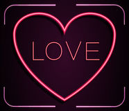 Neon red heart with inscription LOVE on a pink background Stock Images