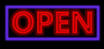 Neon red open sign. A red Neon sign which says open sign in blue with fluorescent light A neon open sign glowing blue in the window of a restaurant Royalty Free Stock Image